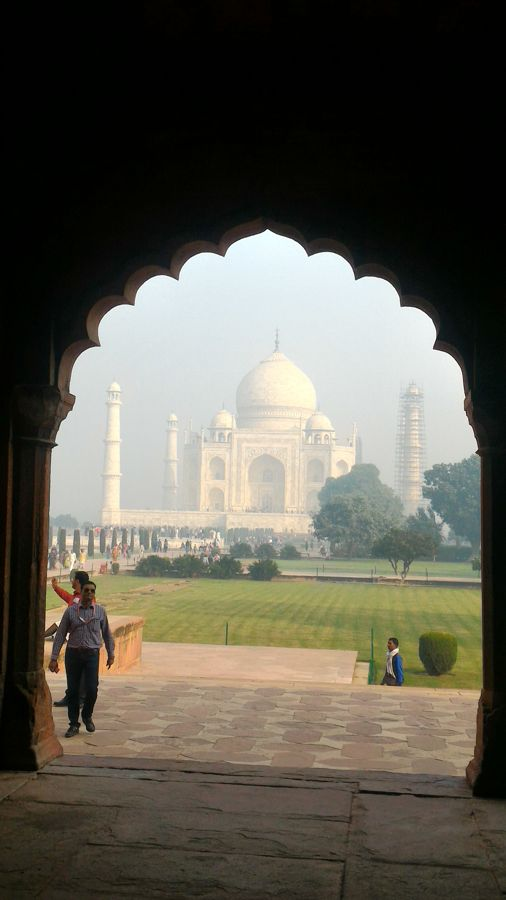 The Taj Mahal framed in the arch way